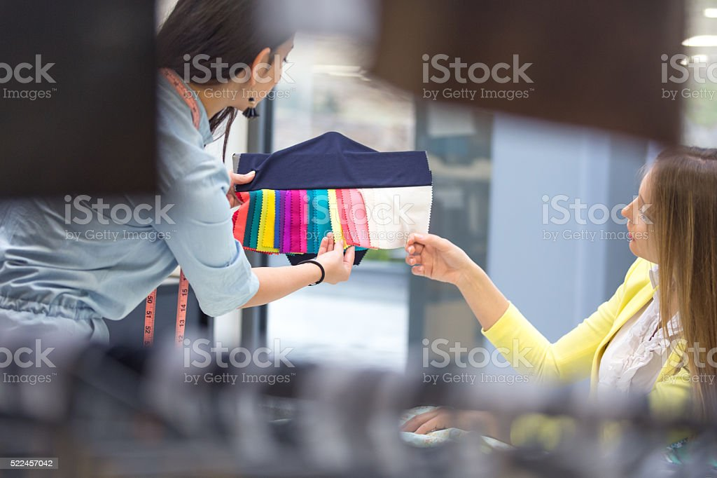 Fashion designers choosing swatches for new models stock photo