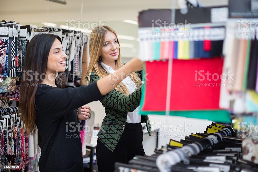 Fashion designers choosing swatches stock photo