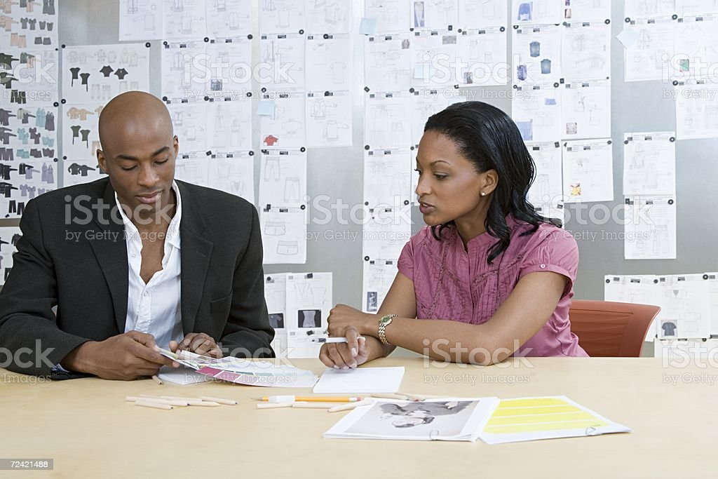 Fashion designers in a meeting royalty-free stock photo