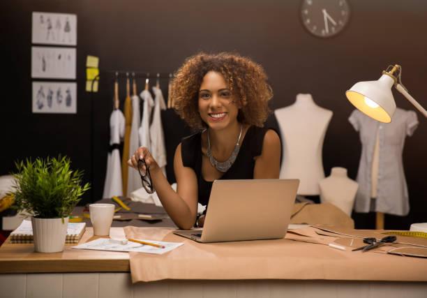 fashion designers - tailor working foto e immagini stock