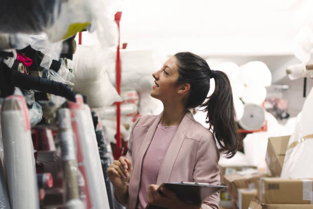 Fashion disagner choosing a fabric in a store stock photo