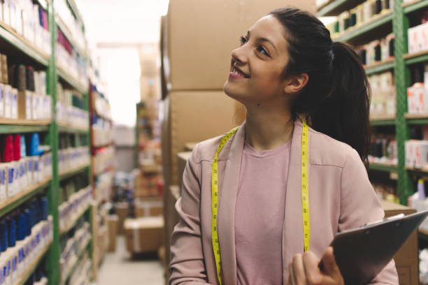 Fashion disagner in a factory stock photo