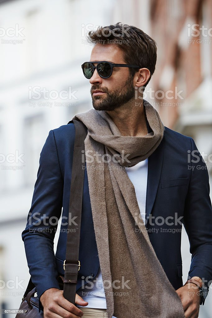 Fashion dude in scarf and shades, looking away photo libre de droits