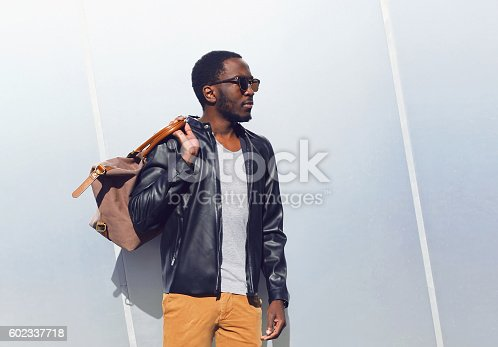 istock Fashion elegant african man with bag in city 602337718
