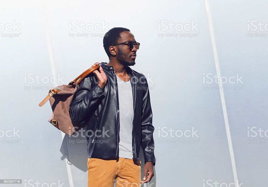 Fashion elegant african man with bag in city - Photo