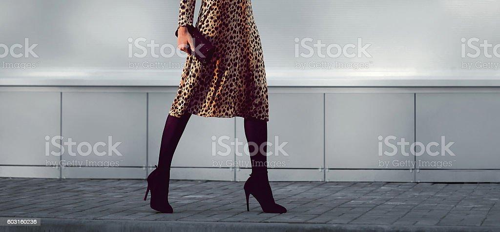 fashion elegant woman in dress on heels with handbag walking stock photo