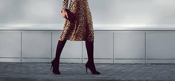 fashion elegant woman in dress on heels with handbag walking - foto de stock