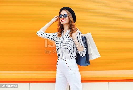 istock Fashion elegant young smiling woman model with shopping bags 615594738