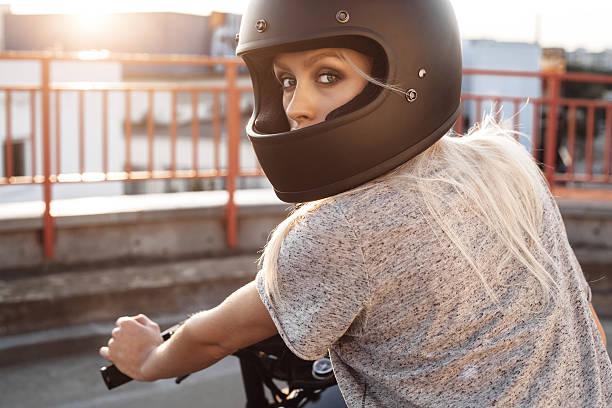 fashion female biker girl with vintage custom motorcycle stock photo