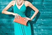 Fashion female model with purse handbag