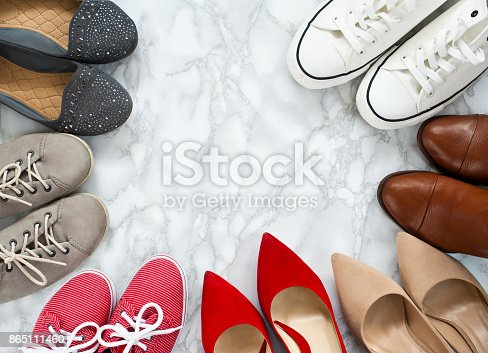 istock Fashion flatlay - variety of the colorful woman shoes on white, marble, elegant background. 865111460