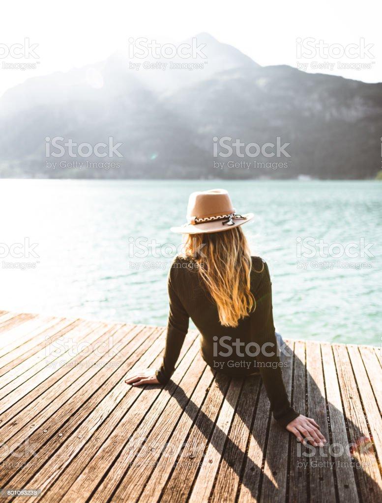 fashion folk woman on the jetty stock photo