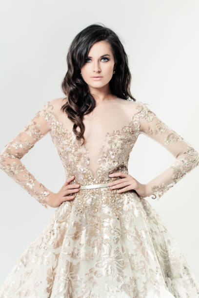 Fashion Girl. Makeup, Jewelry, Gold Dress and Clutch stock photo
