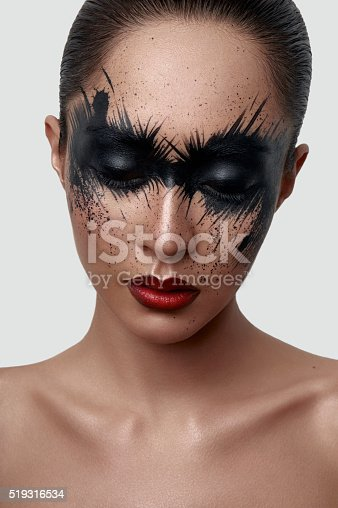 istock Fashion Girl with black Paint Splashes on her Face 519316534