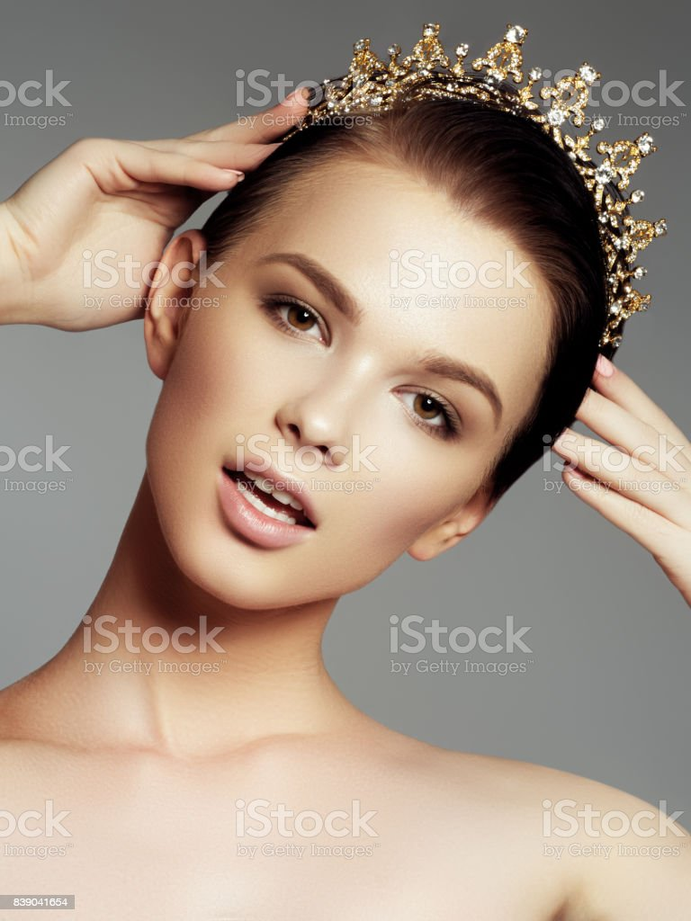 Fashion gorgeous woman in diamond crown, beauty contest winner. Luxury girl with bright makeup stock photo