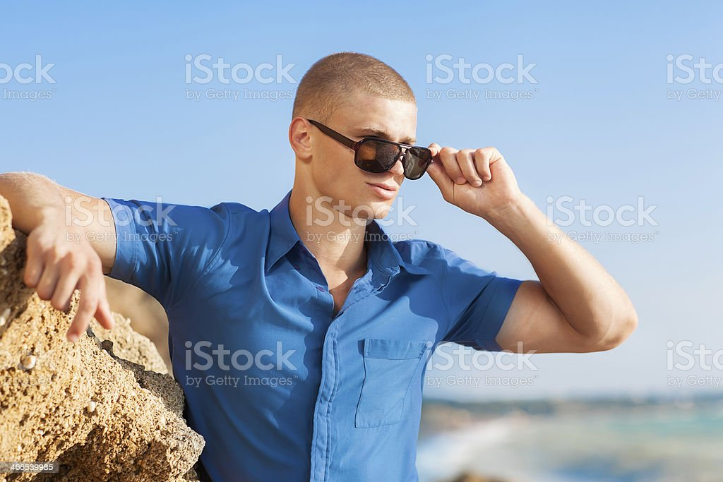 fashion guy on the beach royalty-free stock photo