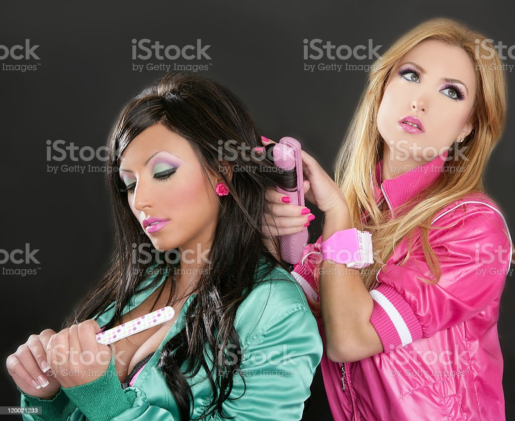 Fashion hairdresser hair iron pink barbie 1980s stock photo
