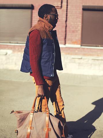627398448 istock photo Fashion handsome stylish african man wearing a vest jacket, swea 492077696