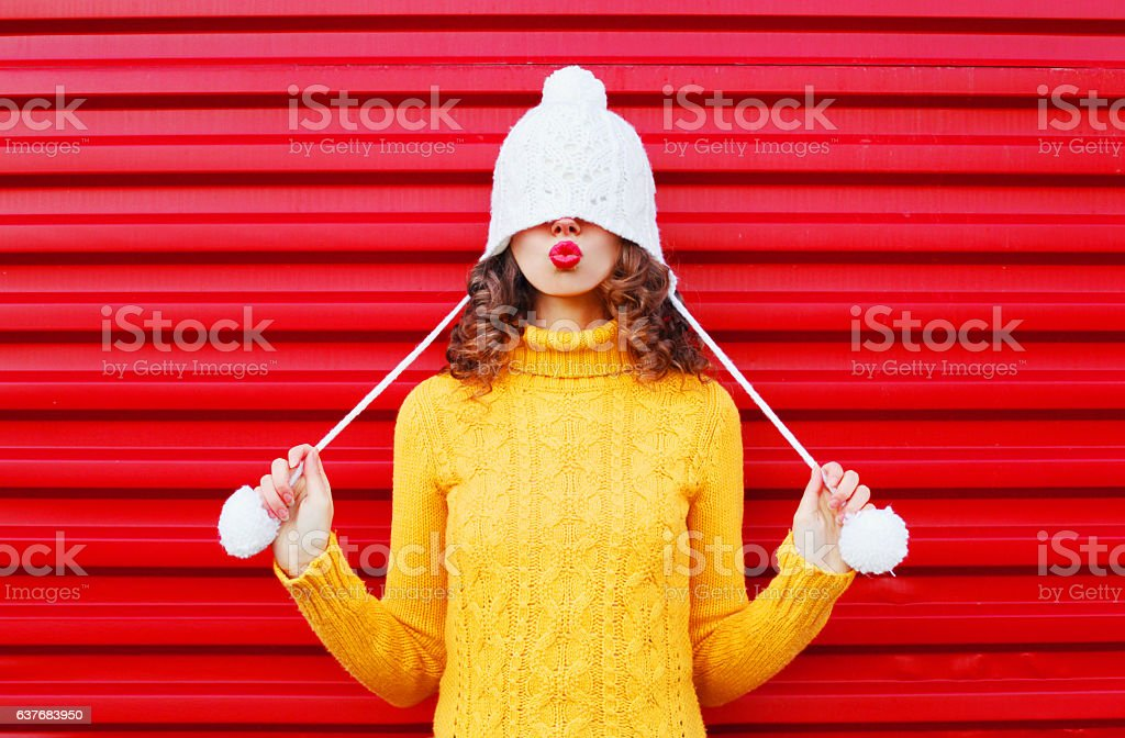 Fashion happy woman blowing red lips makes air kiss stock photo