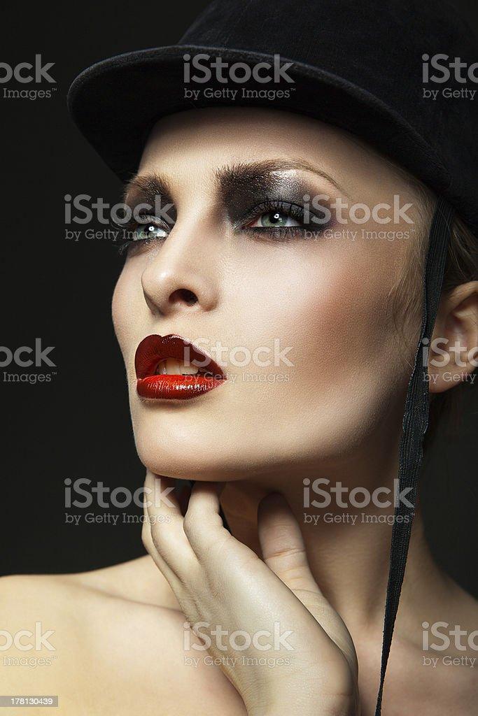 Fashion horsewoman wearing black hat royalty-free stock photo