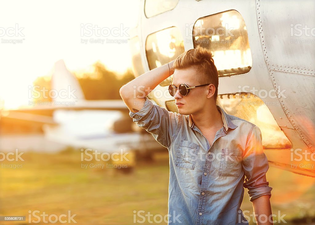fashion in airport at sunset stock photo