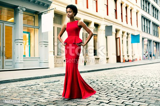 Woman wearing a red gown in Soho, New York