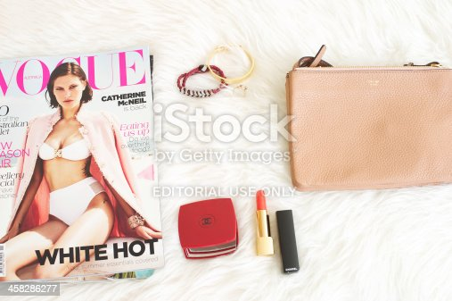 Milan, Italy, October 23, 2012: Fashion items for every fashion girl, chanel makeup, chanel bag and vogue magazine