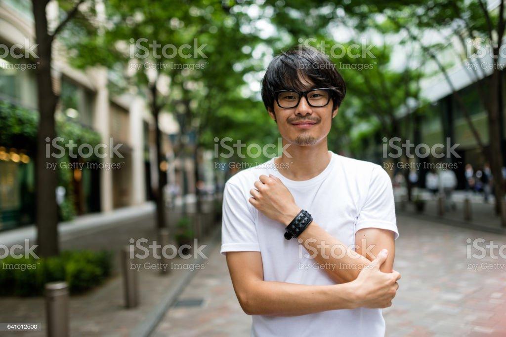 fashion japanese adult man walking stock photo