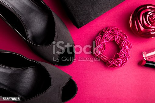 539853444 istock photo Fashion Lady Accessories Set. Black and pink. Minimal. Black Shoes, bracelet, perfume, lipstick and bag on pink background. Flat lay. 873278818