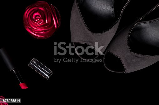 539853444 istock photo Fashion Lady Accessories Set. Black and pink. Minimal. Shoes, bracelet, perfume, lipstick and bag on black background. Flat lay. 873278814