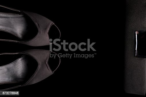 istock Fashion Lady Accessories Set. Minimal. Black Shoes and bag on black background. Flat lay. 873278848