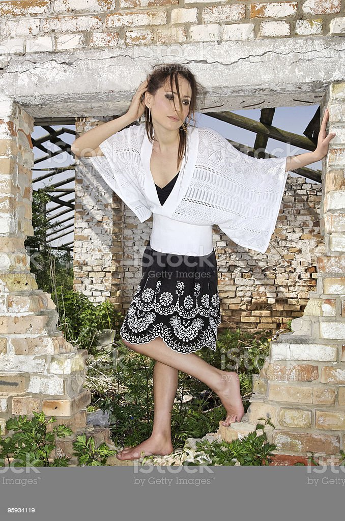 Fashion lady in a ruined fenestra stock photo