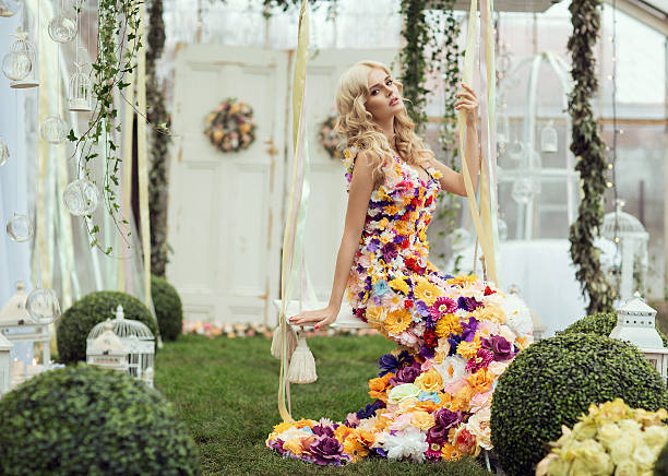 fashion lady in spring scenery wearing flower dress - spring fashion stock pictures, royalty-free photos & images