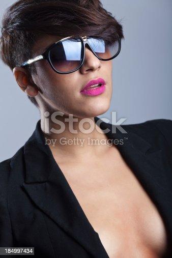 istock Fashion Latin young woman wearing Sunglasses 184997434