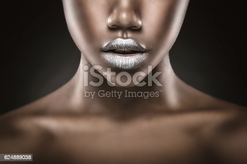 Fashion makeup. Close-up of silver lips African American young woman