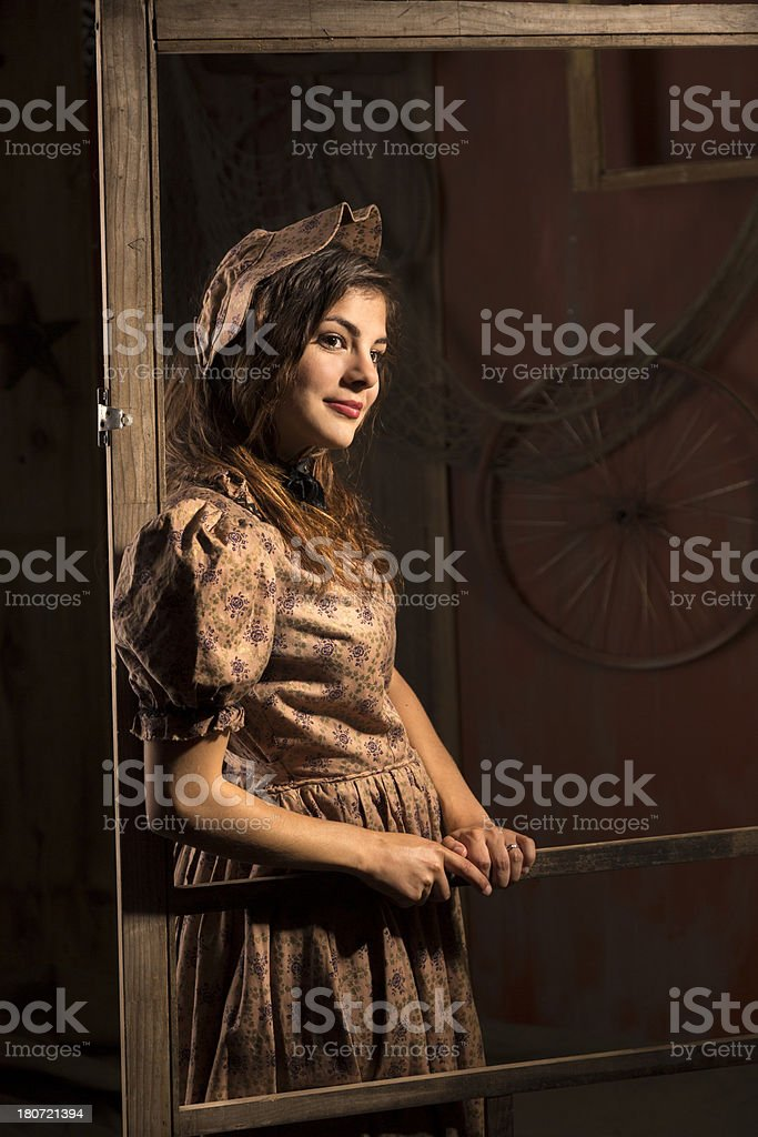 Fashion: Lovely young woman in 1800's Western period dress stock photo