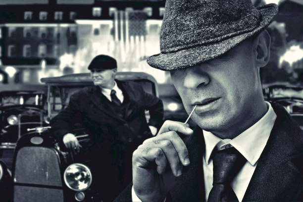 fashion mafia gansters fashion bossy Italian mafia gangster in 1930's near classic car gangster stock pictures, royalty-free photos & images