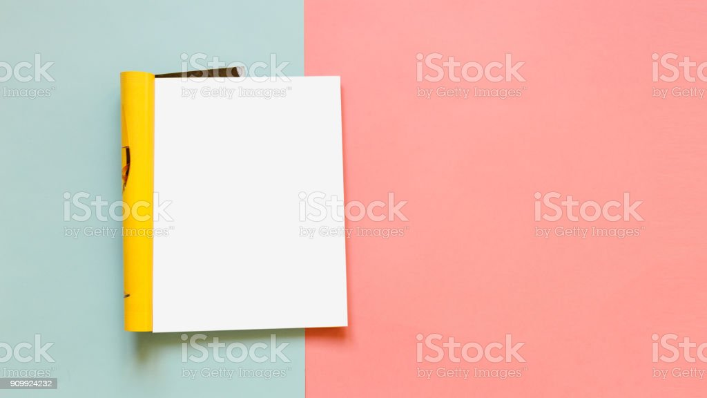 Fashion magazine template on a pink and blue background. Mock up....