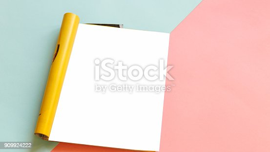 909924232 istock photo Fashion magazine template on a pink and blue background. Mock up. 909924222