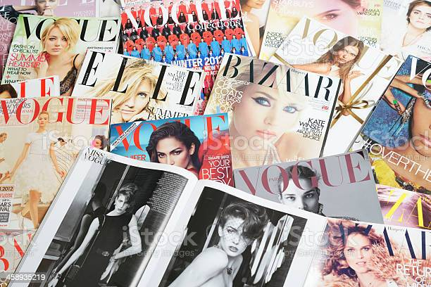 """""""Seoul, Korea - September 9, 2012:Studio product shot of covers and fashion spread of fashion  magazines, VOGUE, ELLE and Harper's BAZAAR for research and making up a fashion story."""""""