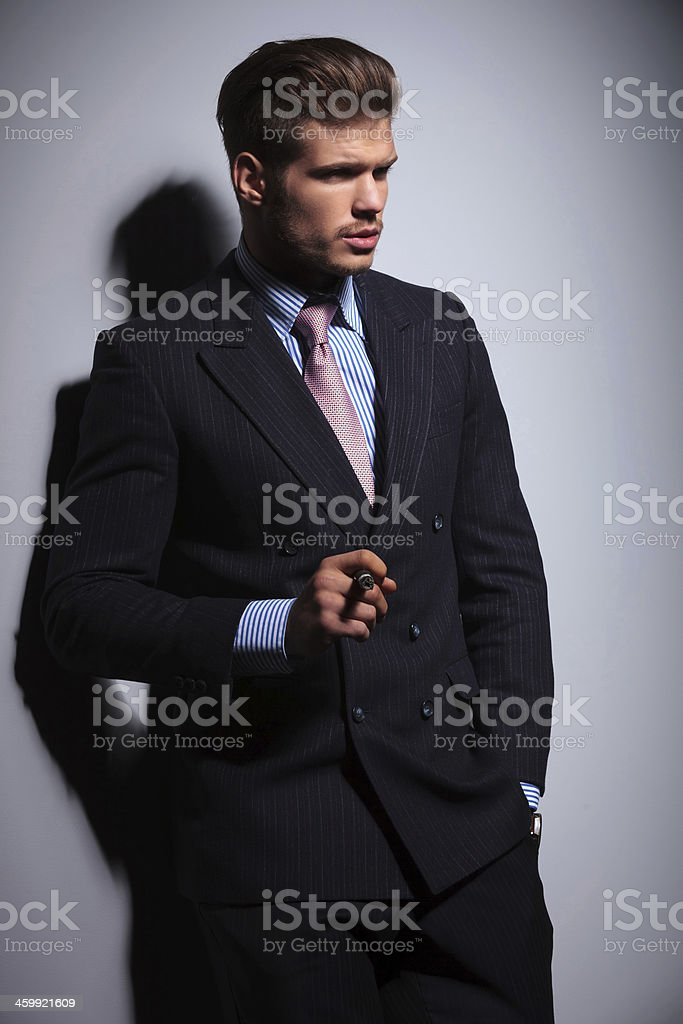 fashion man in suit and tie smoking a cigar stock photo