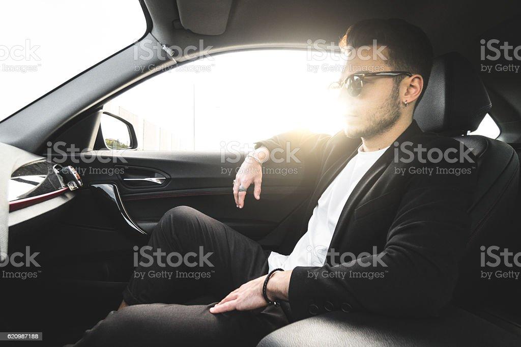 fashion man on the passenger seat foto royalty-free
