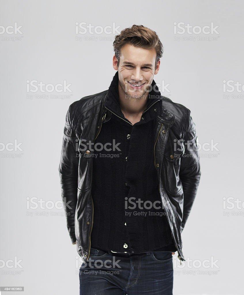 Fashion man smile over gray background stock photo