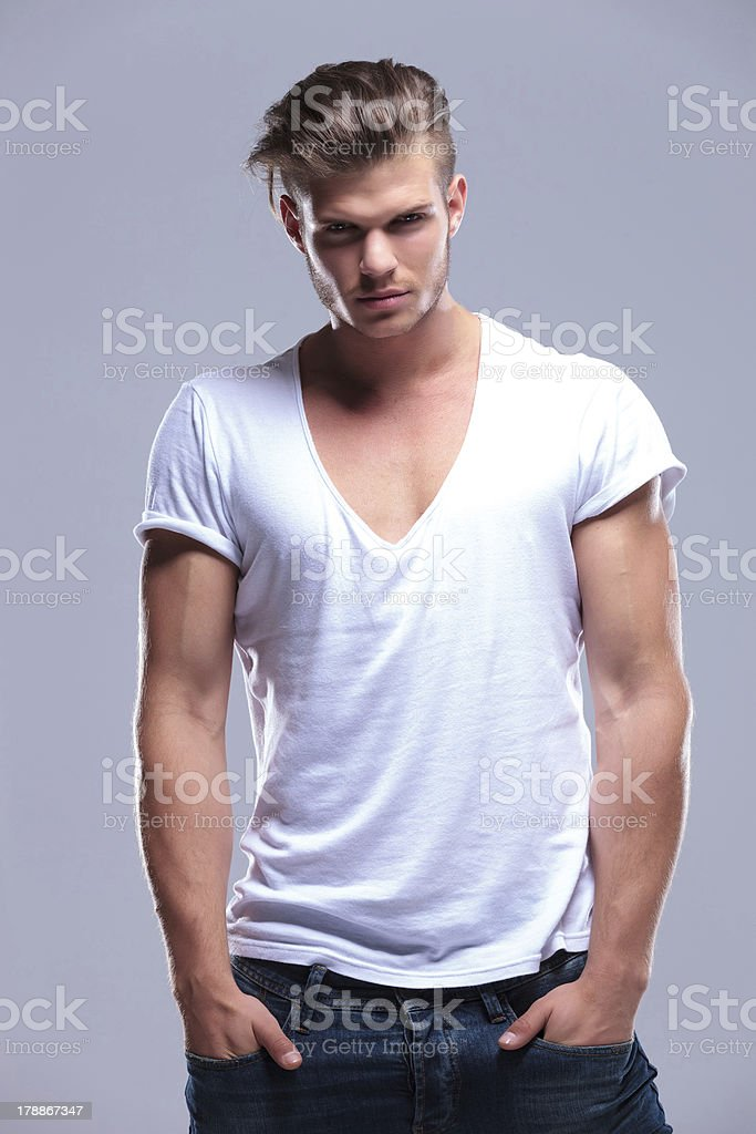 fashion man stands with hands in pockets royalty-free stock photo