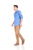 istock fashion man walking on isolated background. 585521192