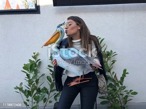 Young woman holding maquette of Albatross