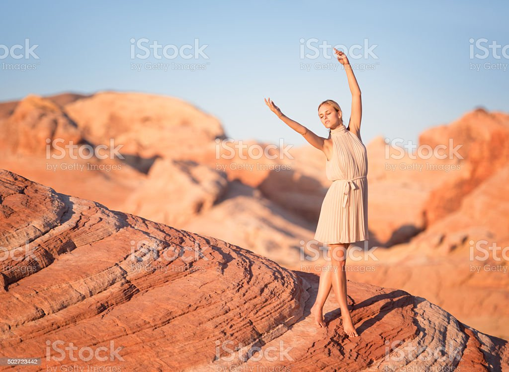 Fashion meets Nature, Woman in a Sand Stone Wave stock photo