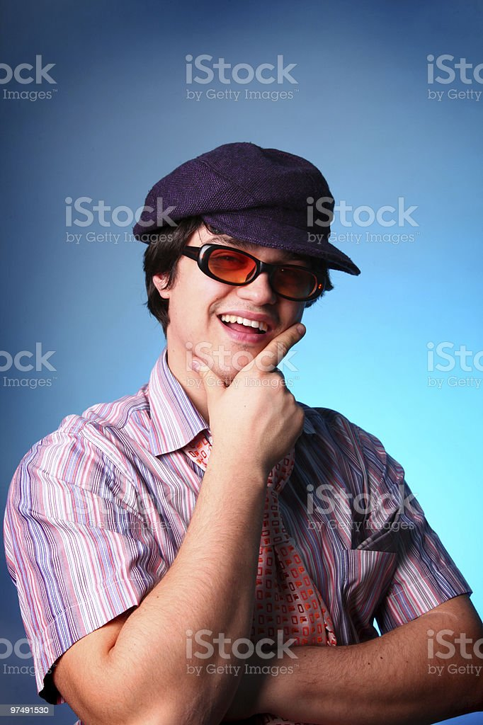 Fashion men in cap and sunglasses royalty-free stock photo