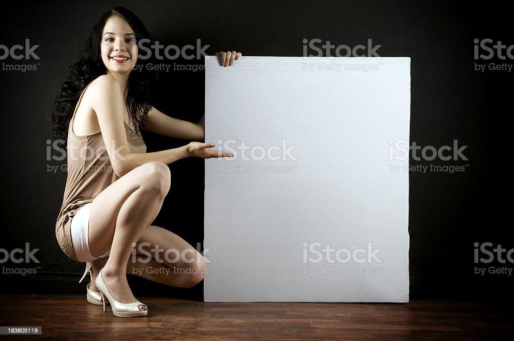 Fashion model and empty billboard royalty-free stock photo