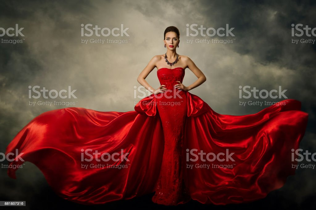 Fashion Model Art Dress, Elegant Woman in Red Retro Gown, Silk Fabric Fluttering in Storm stock photo